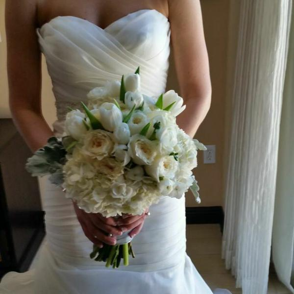 White hydrangeas, garden roses, ranunculus and white tulips